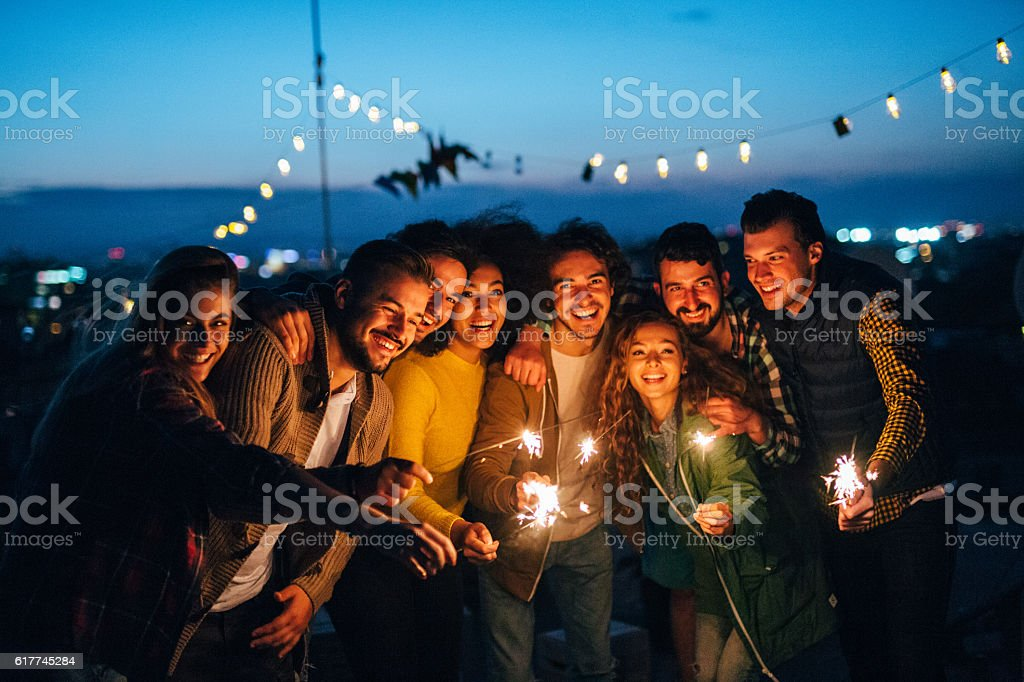 Celebratng on the roof stock photo