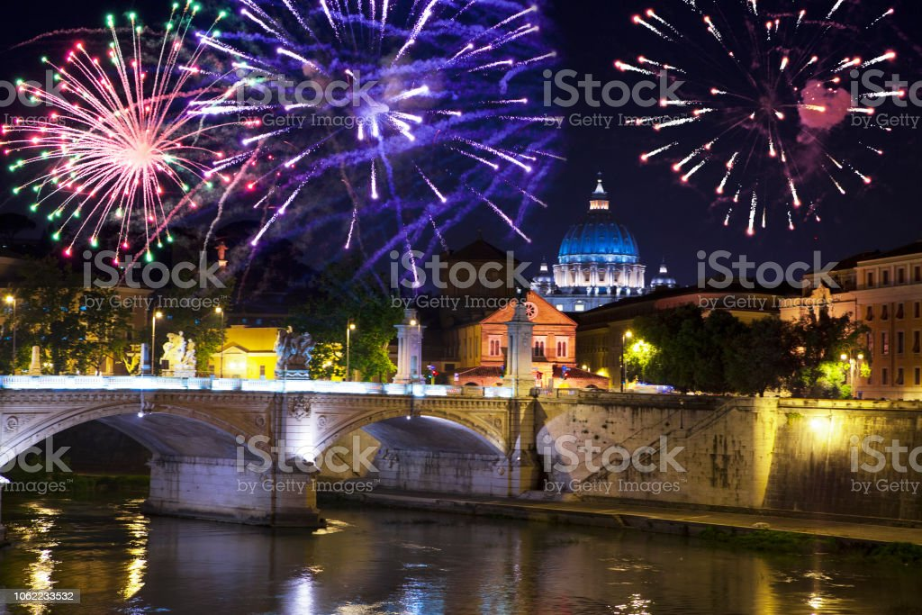 Celebratory fireworks over Sant' Angelo Bridge. River Tiber. Rome. Italy. stock photo
