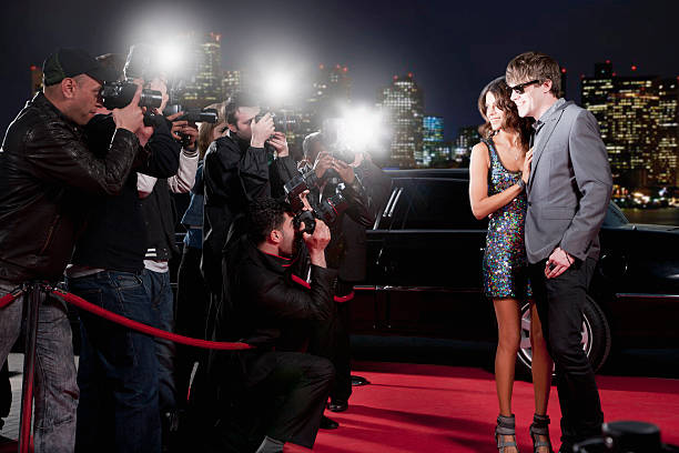 Celebrities posing for paparazzi on red carpet picture id130407090?b=1&k=6&m=130407090&s=612x612&w=0&h=ih7zfr8iscpds8riqxryceumx2gcw5bvblxi26osf50=