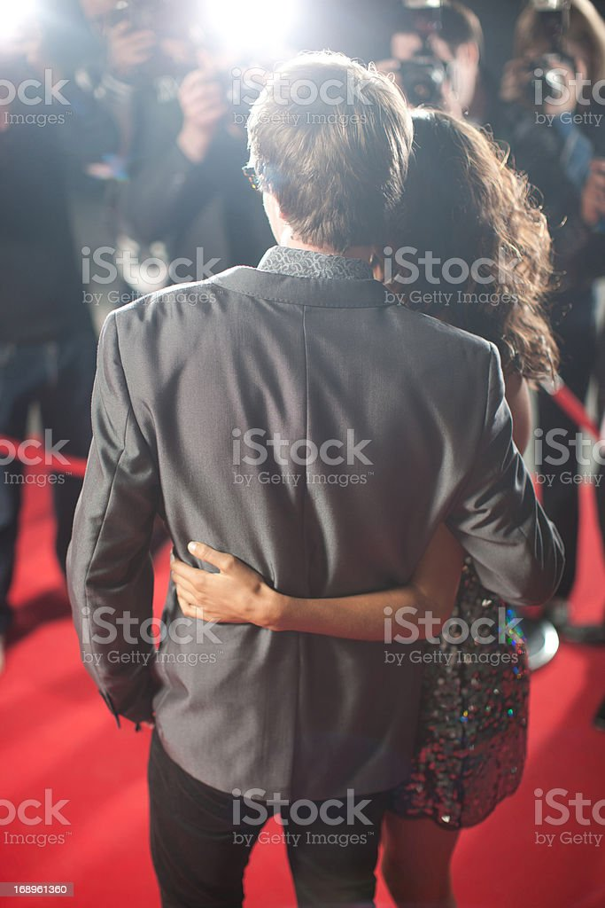 Celebrities posing for paparazzi on red carpet royalty-free stock photo