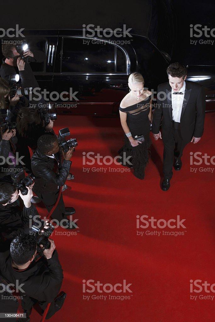 Celebrities walking on red carpet royalty-free stock photo