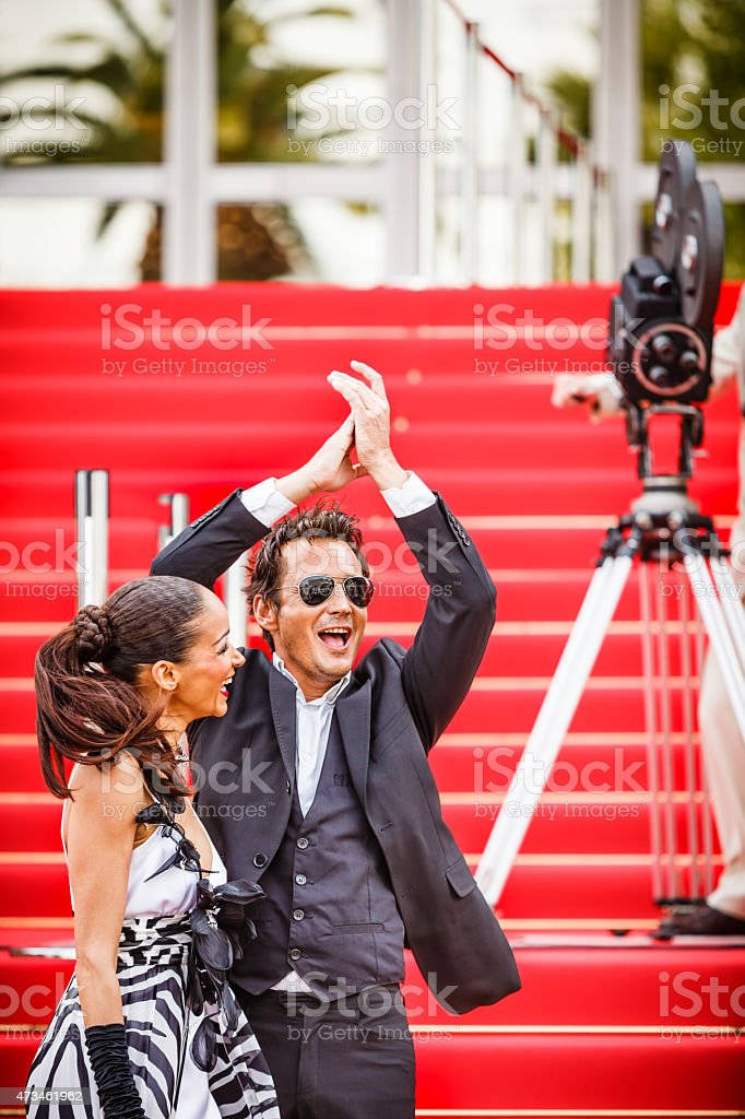 Celebrity couple on red carpet in Cannes stock photo