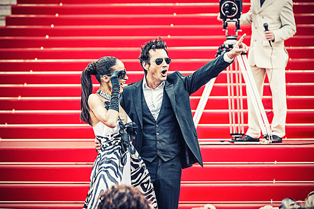 celebrity couple on red carpet in cannes - fame stock pictures, royalty-free photos & images