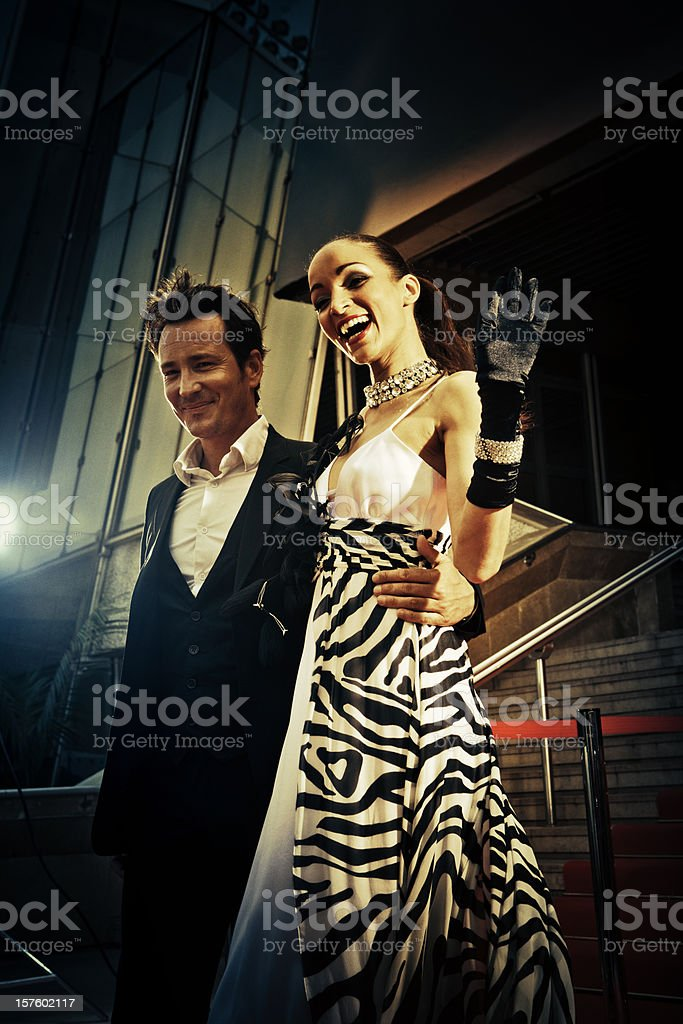 Celebrity couple walking down the red carpet stock photo