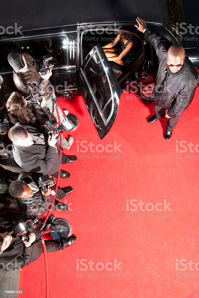 Celebrity getting out of limo on red carpet royalty-free stock photo