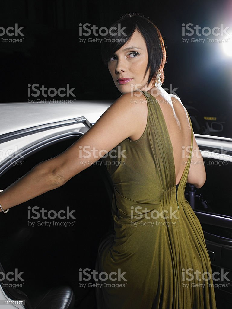 Celebrity In Evening Wear Getting Into Limousine royalty-free stock photo