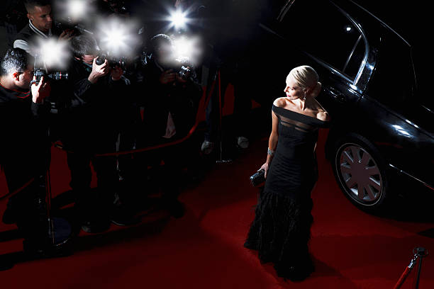Celebrity posing for paparazzi on red carpet picture id130407822?b=1&k=6&m=130407822&s=612x612&w=0&h=d3jqb6a15uakfgw6zpwzq1ubshphmaraobsvzvgysim=