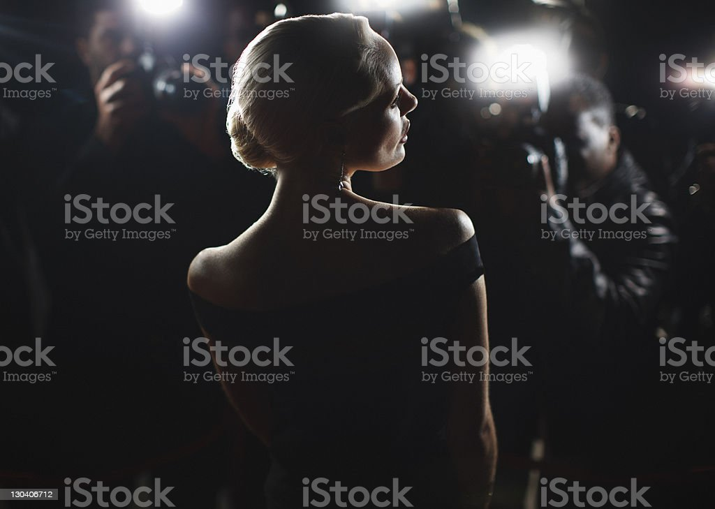 Celebrity posing for paparazzi stock photo
