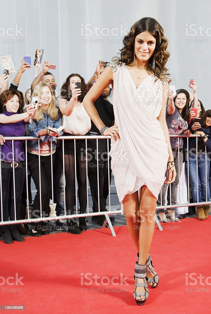 Celebrity posing on red carpet stock photo
