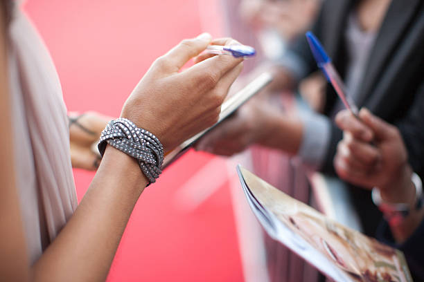 celebrity signing autographs for fan - fame stock photos and pictures