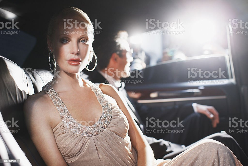 Celebrity sitting in backseat of car stock photo