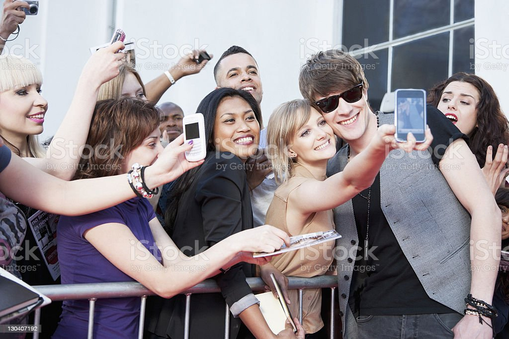 Celebrity taking pictures with fans stock photo