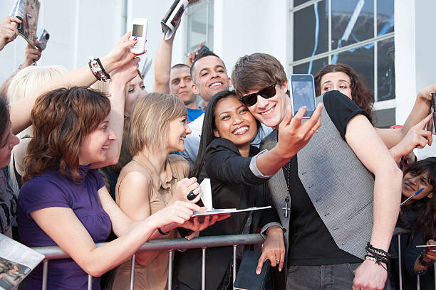 celebrity taking pictures with fans - fame stock photos and pictures