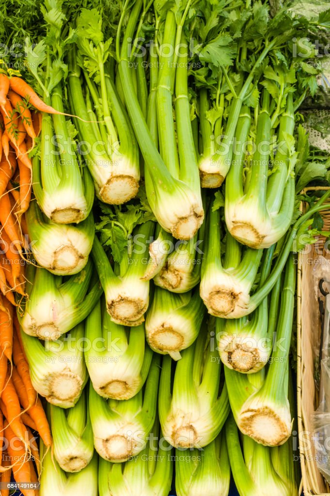 Celery and carrots at the farmers market royalty free stockfoto