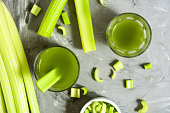 Celery Healthy Green Juice glasses top view on grey background