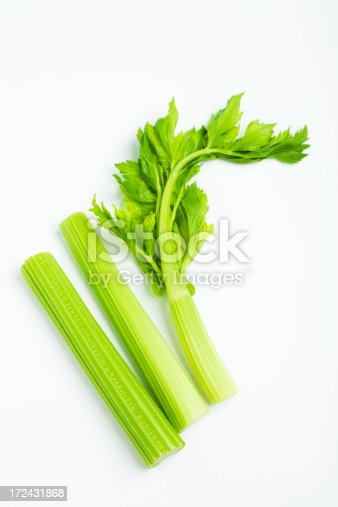 celery stalk with leaves on white