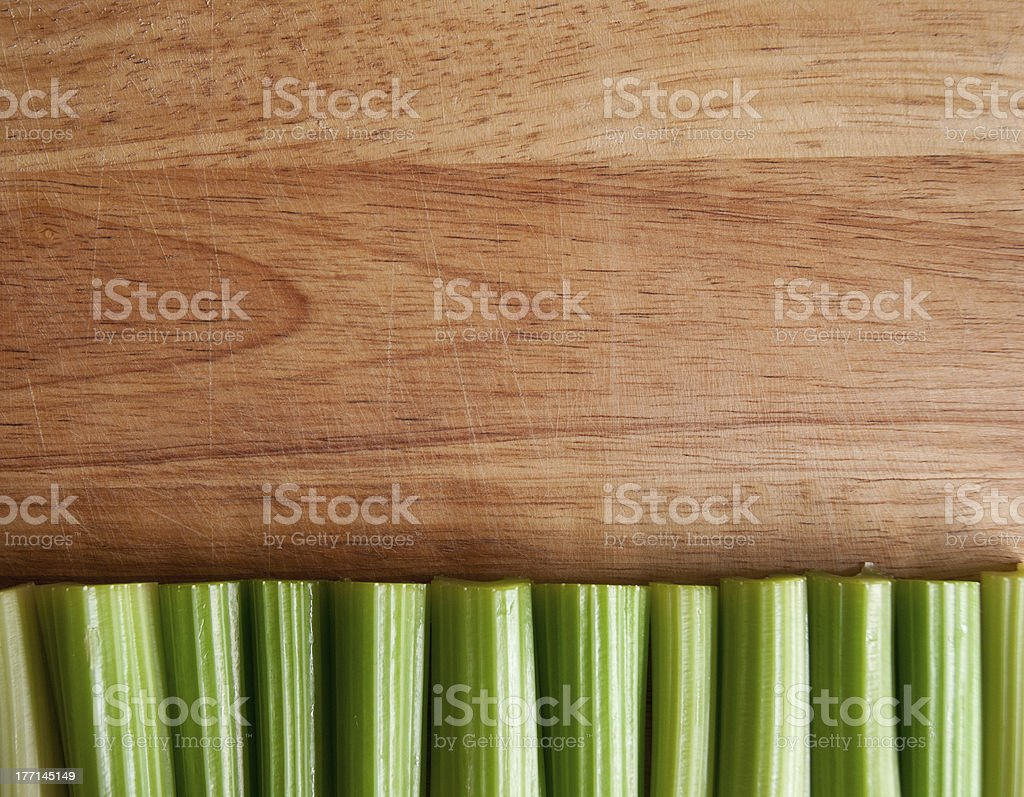 Celery stalks against wood royalty-free stock photo
