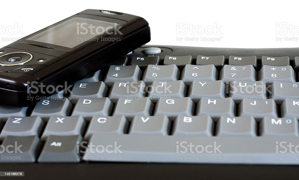 Cell Phone and keyboard royalty-free stock photo