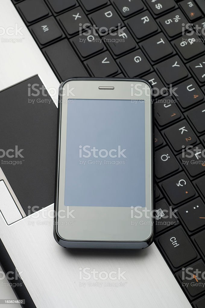 cell phone and laptop royalty-free stock photo