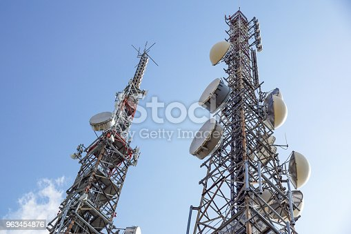 istock Cell phone antenna or aerial tower used for GSM and UMTS mobile phone transmissions 963454876
