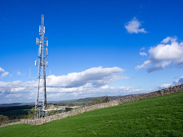 cell phone communication mast in green field - 2015 stok fotoğraflar ve resimler