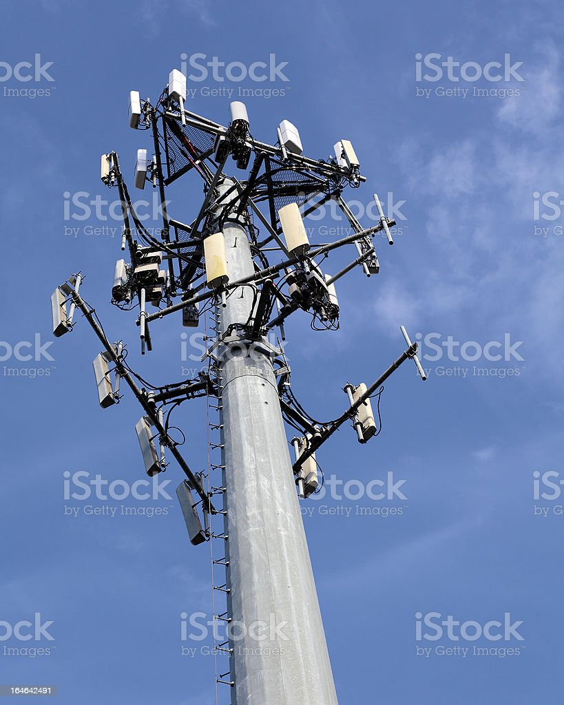 Cell phone communications  tower on blue sky royalty-free stock photo