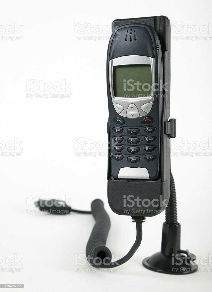 Cell phone in car holder royalty-free stock photo