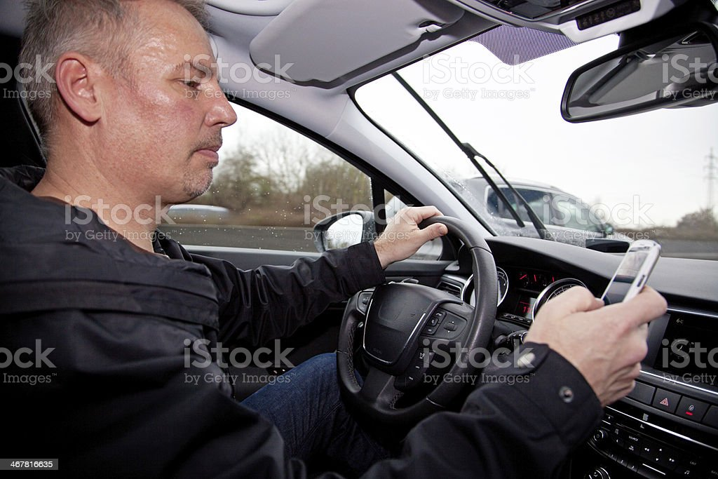 cell phone in the car stock photo