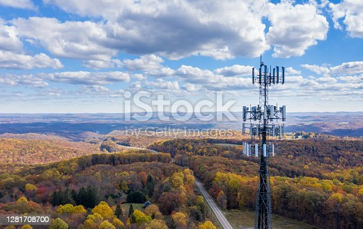 istock Cell phone or mobile service tower in forested area of West Virginia providing broadband service 1281708700