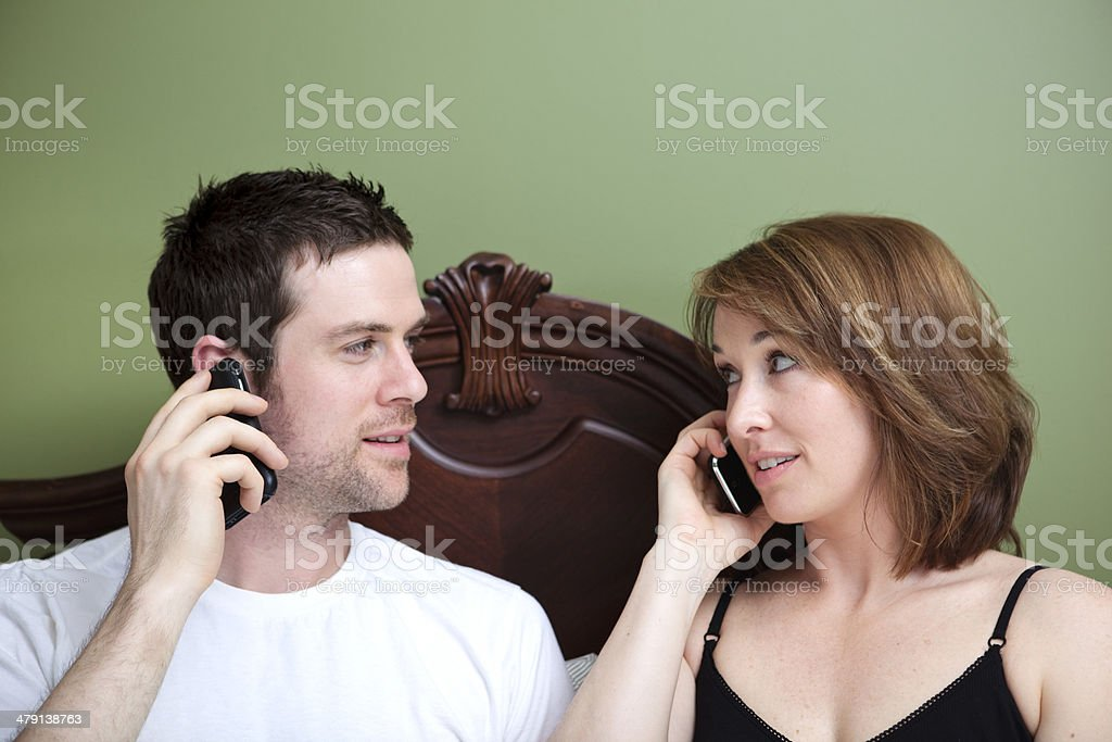 Cell Phone Pillow Talk royalty-free stock photo