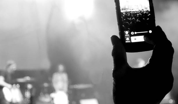 Cell Phone recording a band at a concert stock photo