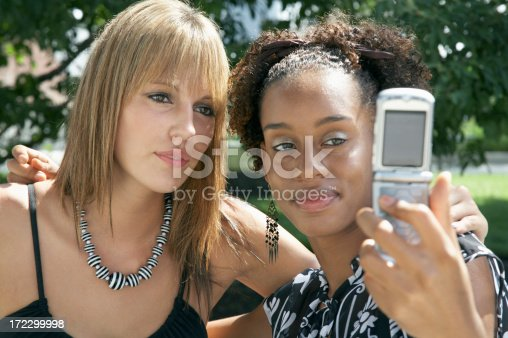 Two women pose for a cell phone picture