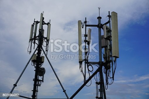istock Cell phone telecommunication tower with clouds,blue sky 802496682