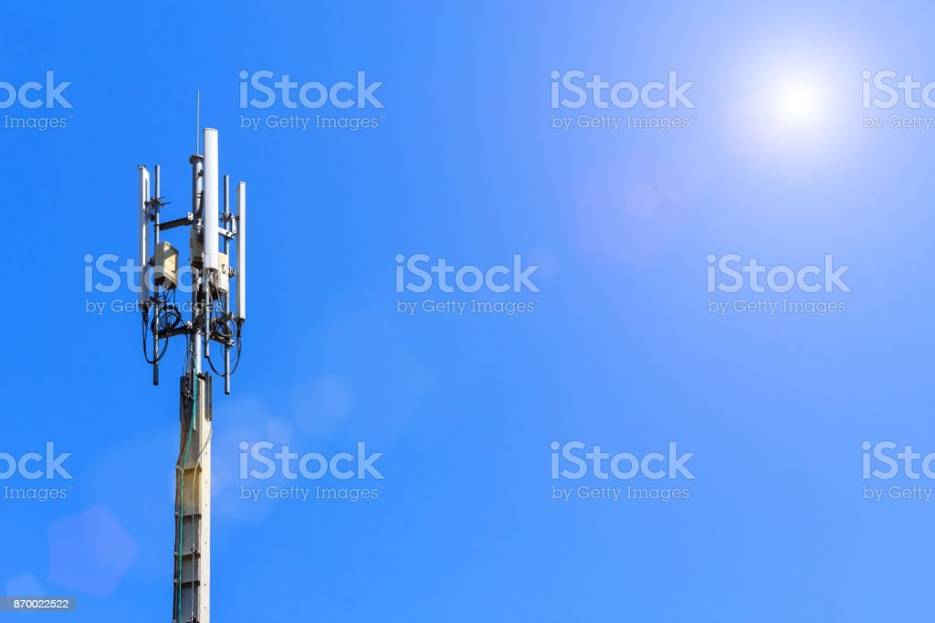 Cell phone tower, Wifi tower,Telecommunication tower in blue sky with sunlight and lens flare background. stock photo