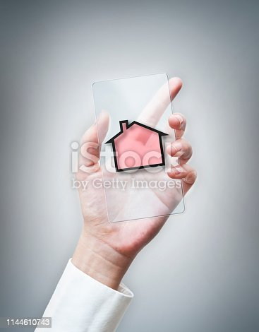 istock HOUSE / Cell phone with house shape app (Click for more) 1144610743