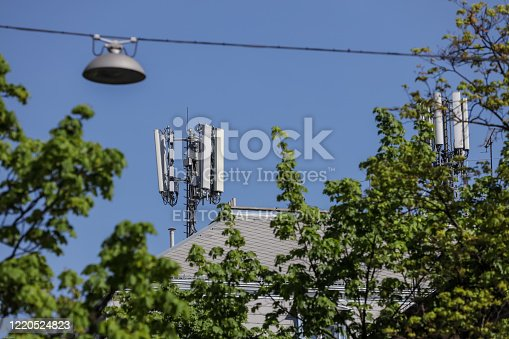 Zagreb, Croatia - April 15, 2020 : Cell sites on the roof of a apartment building in downtown of Zagreb, Croatia.