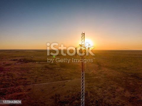 5G Cell Tower: Cellular communications tower for mobile phone and video data transmission, at sunset in New Mexico