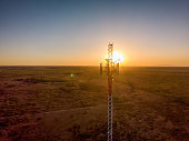 istock 5G Cell Tower At Sunset: Cellular communications tower for mobile phone and video data transmission 1223443524