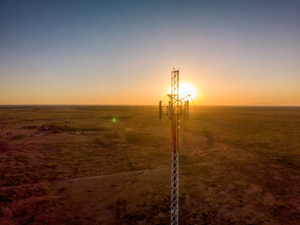 5G Cell Tower At Sunset: Cellular communications tower for mobile phone and video data transmission stock photo