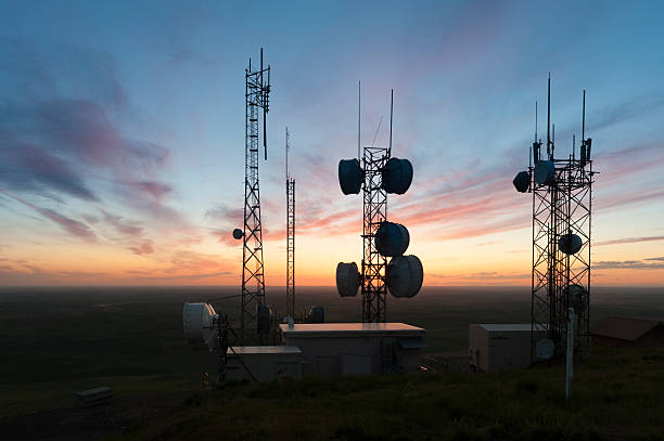 Cell Towers at Sunset stock photo