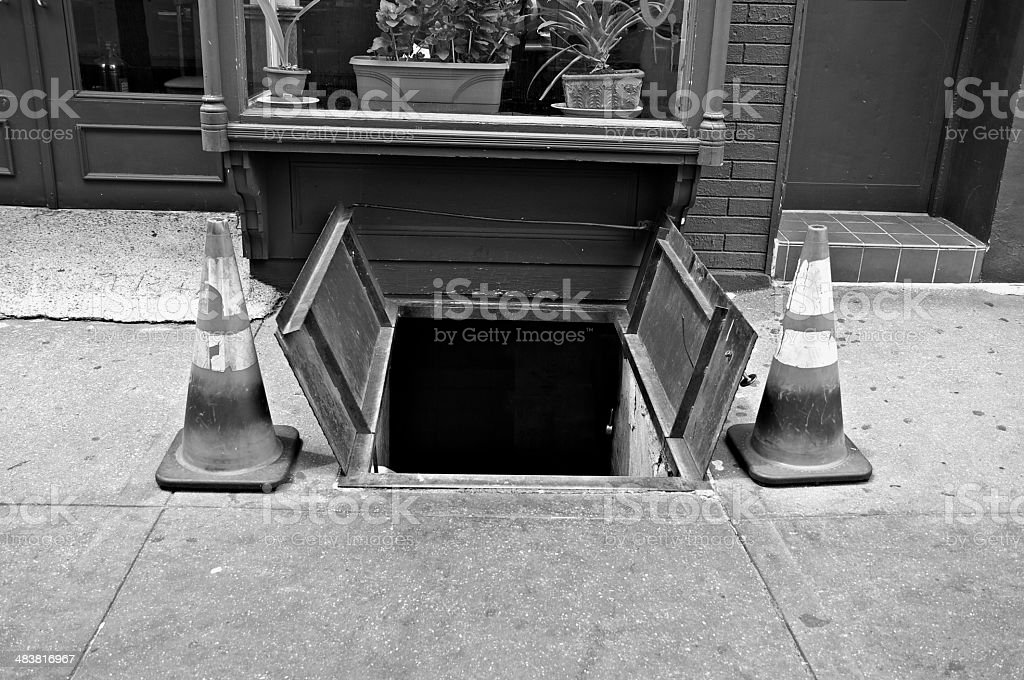 Cellar entrance on Manhattan sidewalk, New York City stock photo