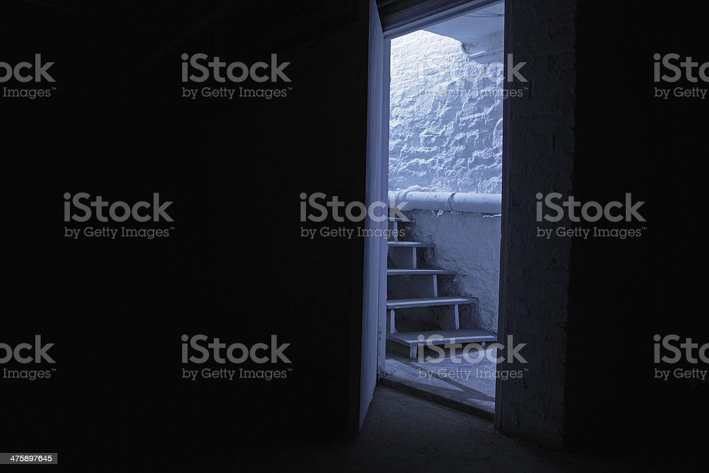 Cellar stairs in blue night shadows stock photo