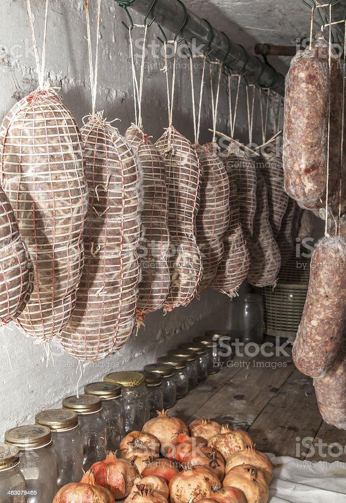 Cellar with handmade Italian salami stock photo