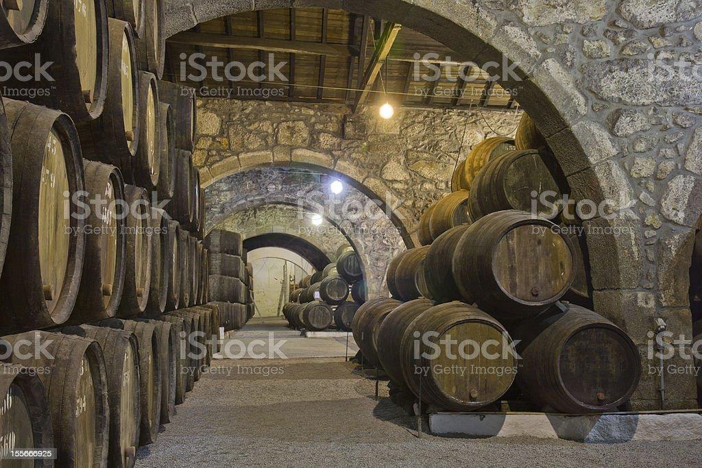 cellar with wine barrels stock photo