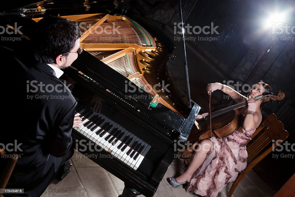 cellist and pianist royalty-free stock photo
