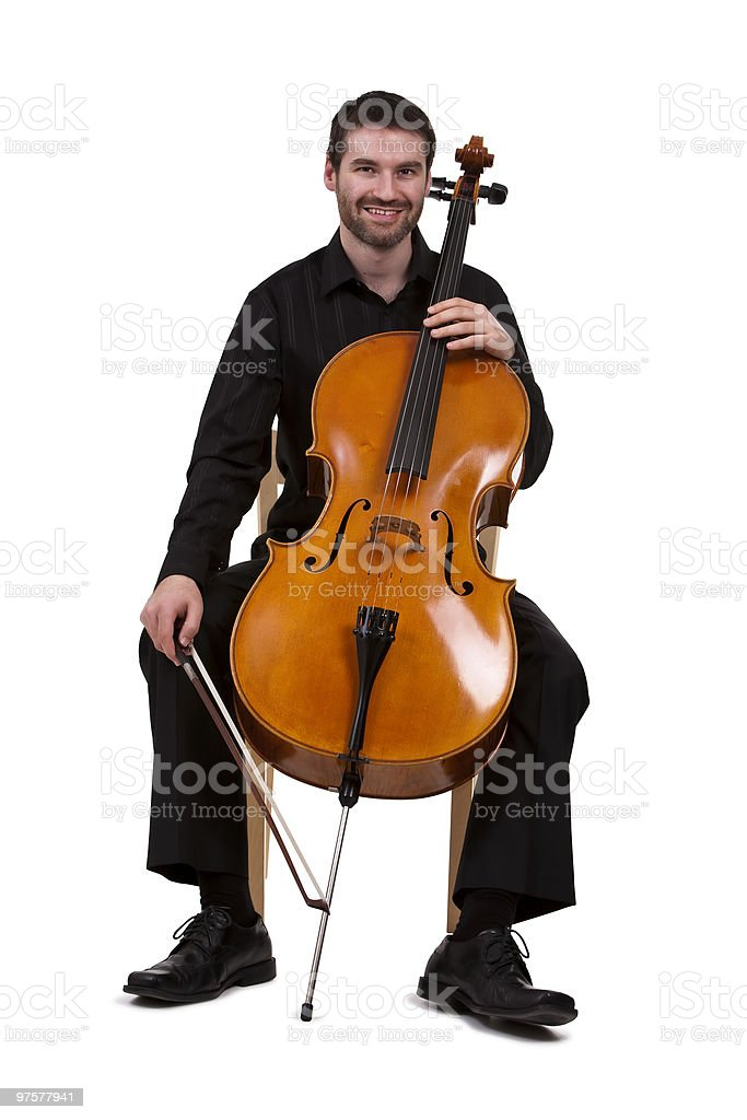 Cellist in studio royalty-free stock photo