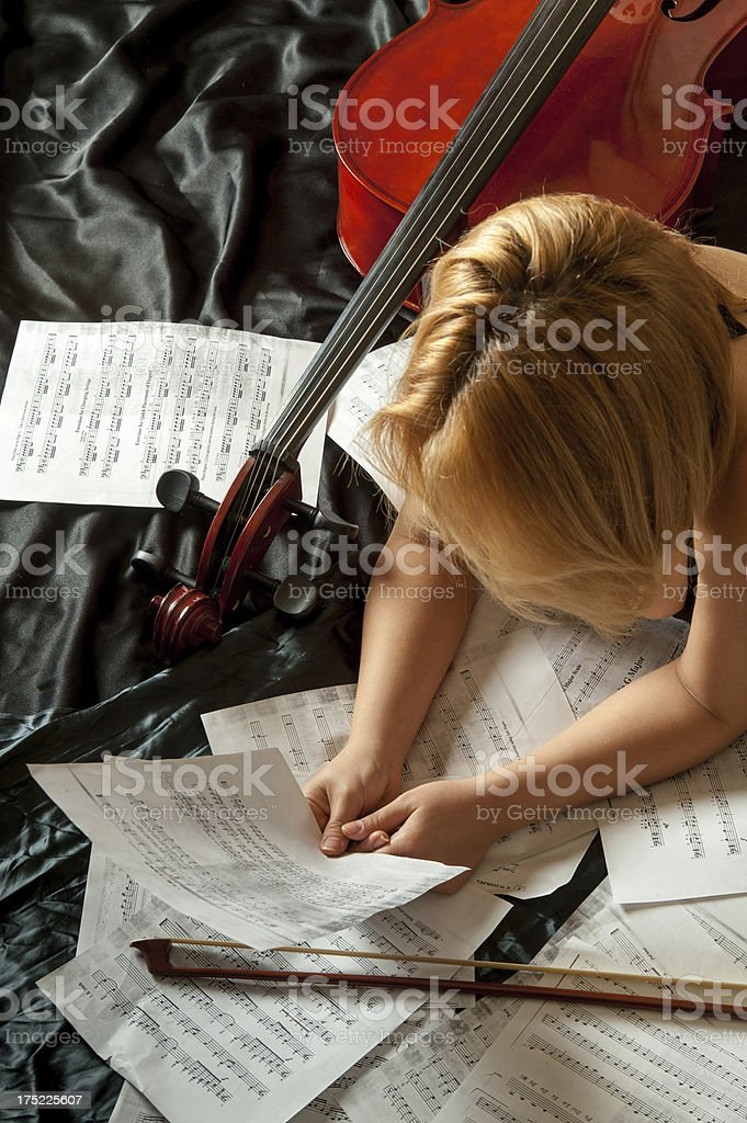 Cellist looking music sheet royalty-free stock photo