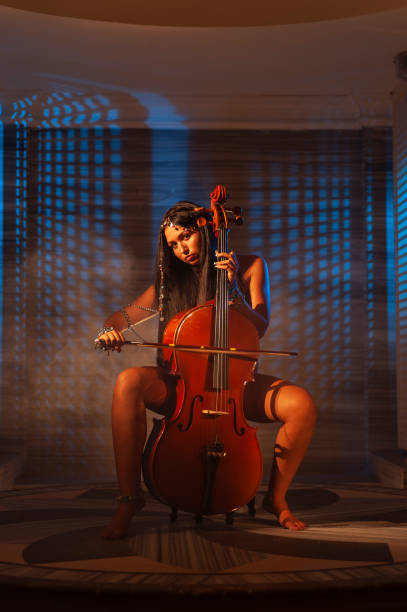Cellist musician woman performing in Turkish bath stock photo