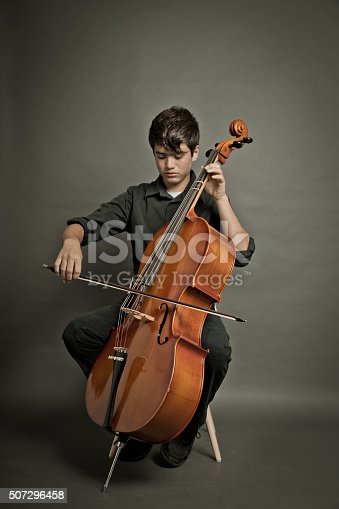 Cellist concentrate on his performance