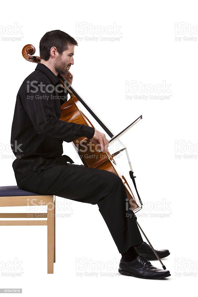 Violoncelliste jouant photo libre de droits